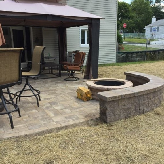 JUST finished patio, fire pit, and seat wall..  Just wait for the grass to grow in!