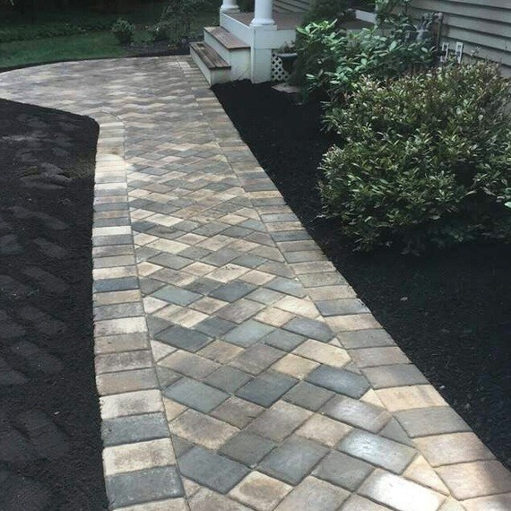 Newly installed two-color herringbone walkway.